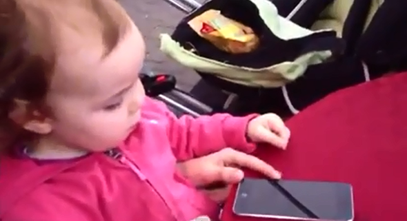 Watch an entertaining video that shows the reaction of a baby to iOS 7 beta