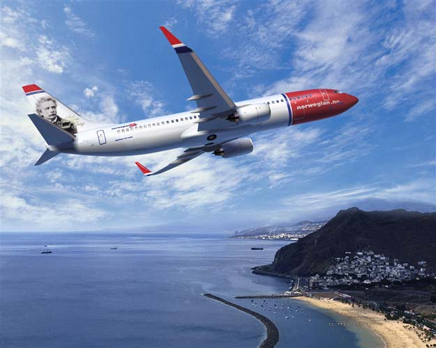 An Air plane of Norwegian AirLines over an island