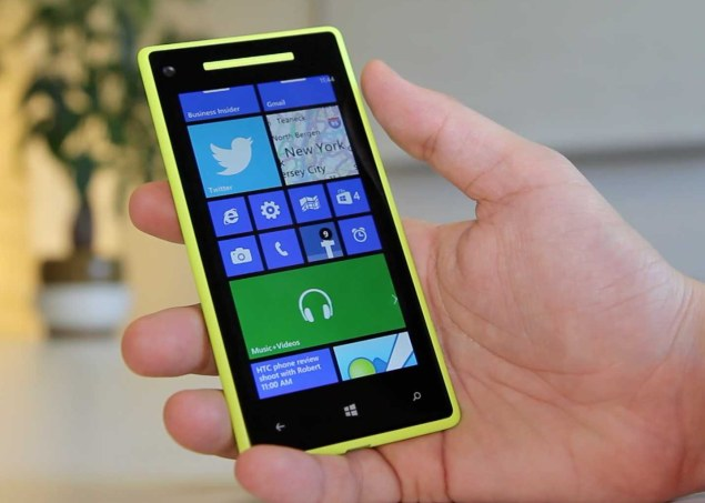 an yellow HTC 8X device running Windows Phone 8 - home screen
